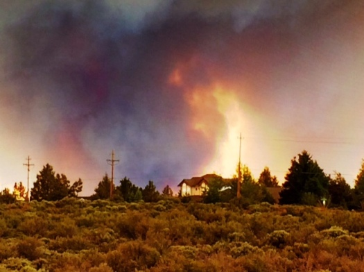 Taken about two blocks from my house.  The yellow isn't flames - its a break in the smoke and the sun coming through.