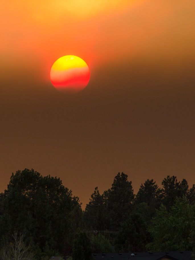 Sun setting behind smoke bank