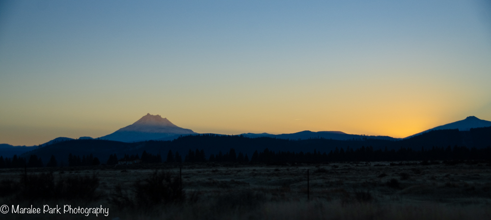 Sun setting behind the Cascade Mountains
